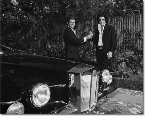 Jules Meyers hands Elvis the keys to his Stutz Blackhawk