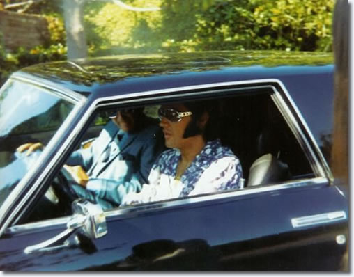 Elvis and John O' Grady leave Elvis' Hillcrest home in his Stutz Blackhawk